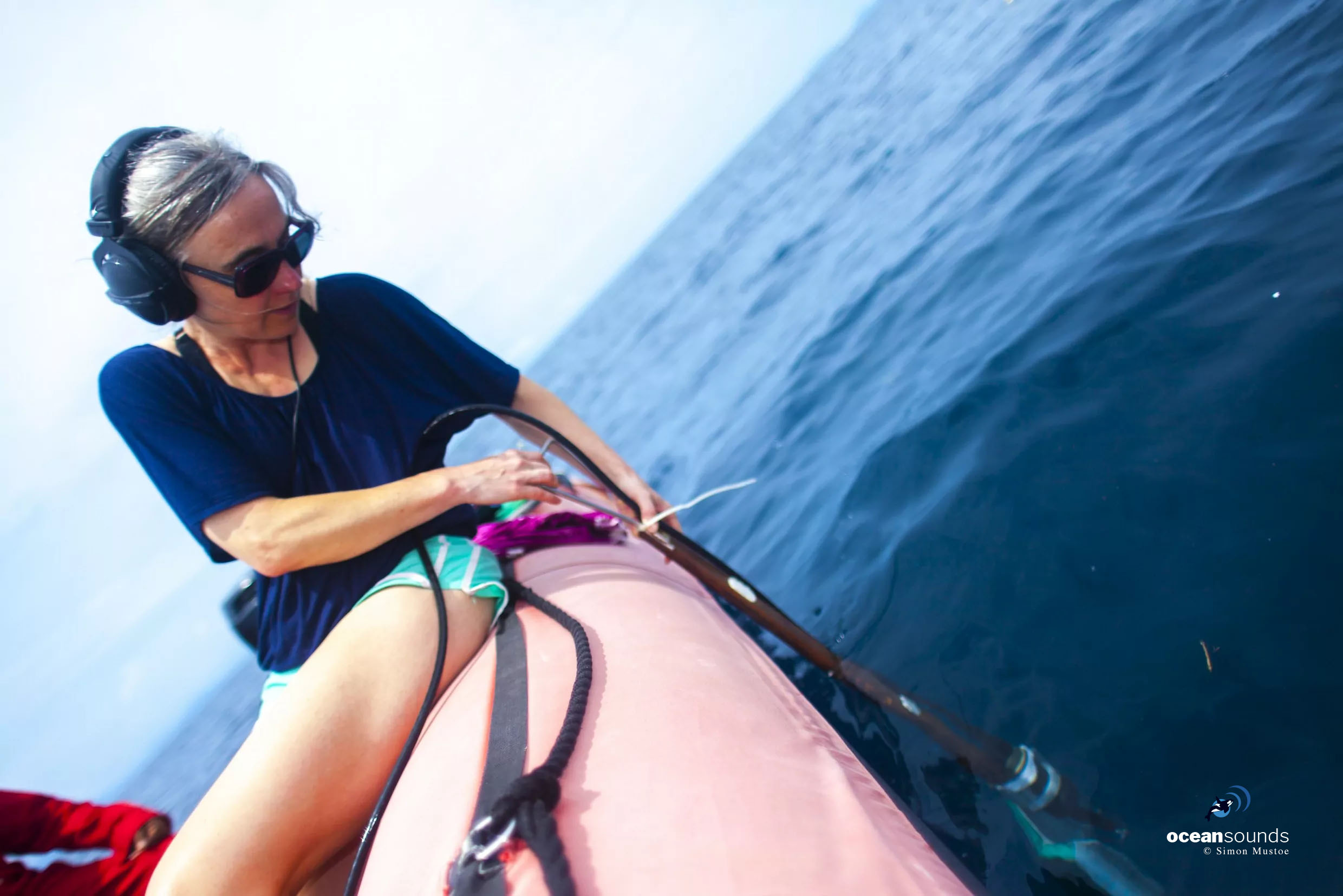 Heike Vester listens for whales using a hydrophone. A metal paddle fitted on one side enables her to identify the direction the sound is coming from.